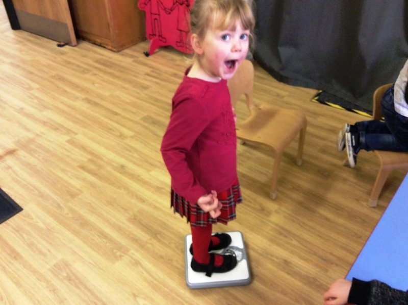 child standing on scales