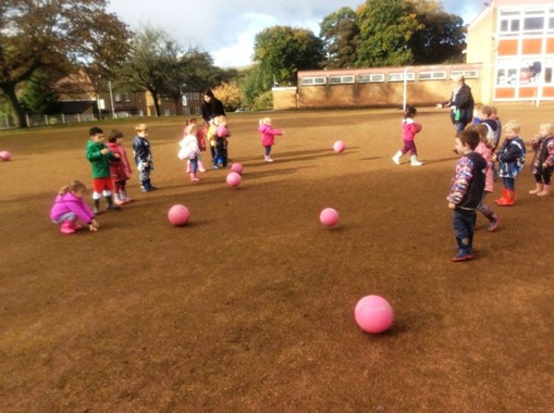 Pink balls and children outdoors
